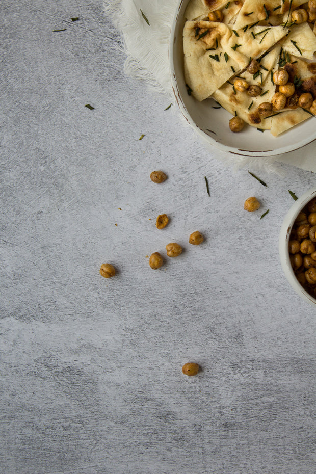 Abstract Concrete Photography Backdrop 2 ft x 3 ft board with roasted chickpeas up close