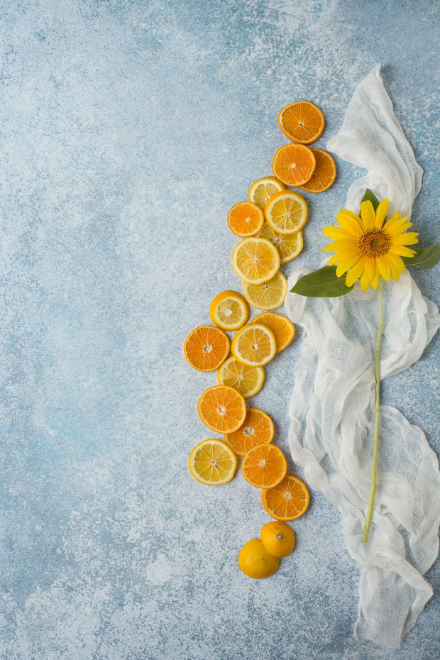Super-Thin & Pliable Blue Stone Photography Backdrop 2 ft x 3ft, Lightweight, Moisture & Stain-Resistant with oranges and lemons