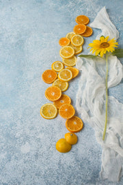 Super-Thin & Pliable Blue Stone Photography Backdrop 2 ft x 3ft, Lightweight, Moisture & Stain-Resistant with a sunflower and oranges