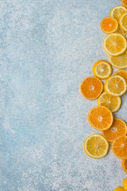 Blue Stone Photography Backdrop 2 ft x 3ft board with oranges and lemon slices lined up