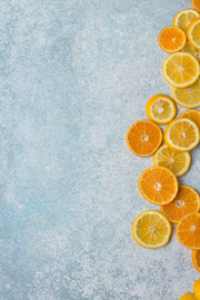 Super-Thin & Pliable Blue Stone Photography Backdrop 2 ft x 3ft, Lightweight, Moisture & Stain-Resistant with lemons and oranges up close