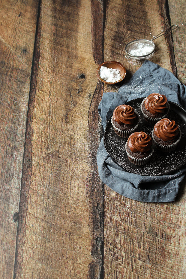 Dark Brown Reclaimed Barn Wood Replica Photography Backdrop 2 ft x 3ft board with chocolate cupcakes on a plate with napkin