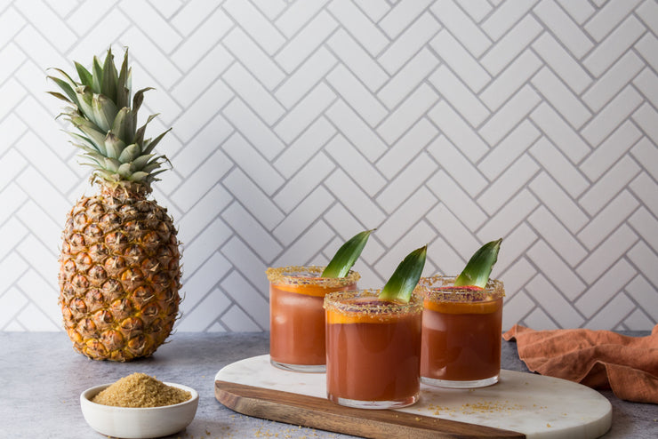 Chevron Tile Replica Photography Backdrop with pineapple drinks and a whole pineapple