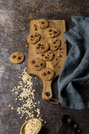 Cookie Sheet Photography Backdrop Board 2 ft x 3 ft | 3 mm thick, Lightweight, Moisture & Stain-Resistant with oats and cookies on a wooden board