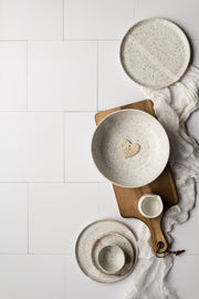 Creamy White Tile Replica Photography Backdrop with white pottery plates and bowls on a wooden board