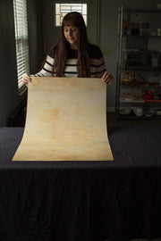 Super-Thin & Pliable Golden Yellow Marble Photography Backdrop 2 ft x 3 ft, Lightweight, Moisture & Stain-Resistant behind the scenes