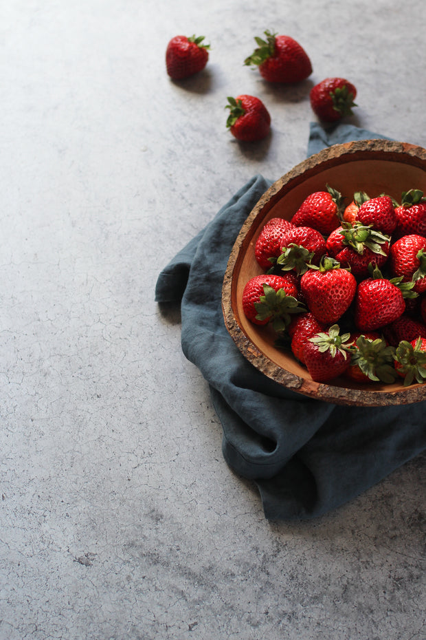 Gray Concrete Photography Backdrop 2 ft x 3 ft | 3 mm thick with strawberries in a bowl on top of linen napkin