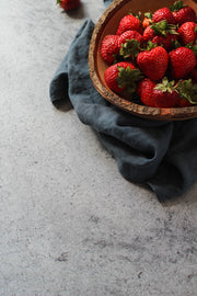 Gray Concrete Photography Backdrop 2 ft x 3 ft | 3 mm thick with strawberries up close