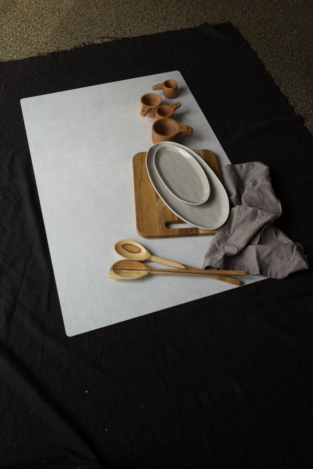 Light Gray Stone Photography Backdrop Board 2 ft x 3 ft | 3 mm thick, Lightweight, Moisture & Stain-Resistant with wooden spoons and cutting board behind the scenes