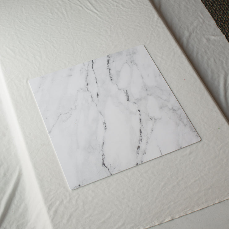 20-inch x 20-inch Marble Photography Backdrop 3 mm thick Physical Board, Lightweight, Moisture & Stain-Resistant behind the scenes on a table