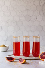 Red sparkling drinks with blood oranges and a Marble Hexagon Tile Replica Photography Backdrop