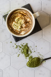 Matcha Hot Chocolate with a spoon of match on a Super-Thin Marble Hexagon Tile Replica Photography Backdrop