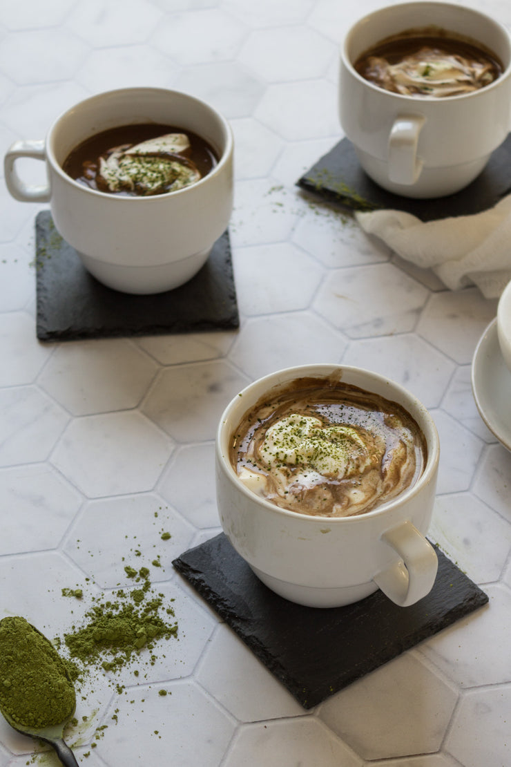 Three cups of matcha hot chocolate on a Super-Thin Marble Hexagon Tile Replica Photography Backdrop