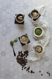 Cups of matcha hot chocolate with matcha tea powder on a Super-Thin Marble Hexagon Tile Replica Photography Backdrop