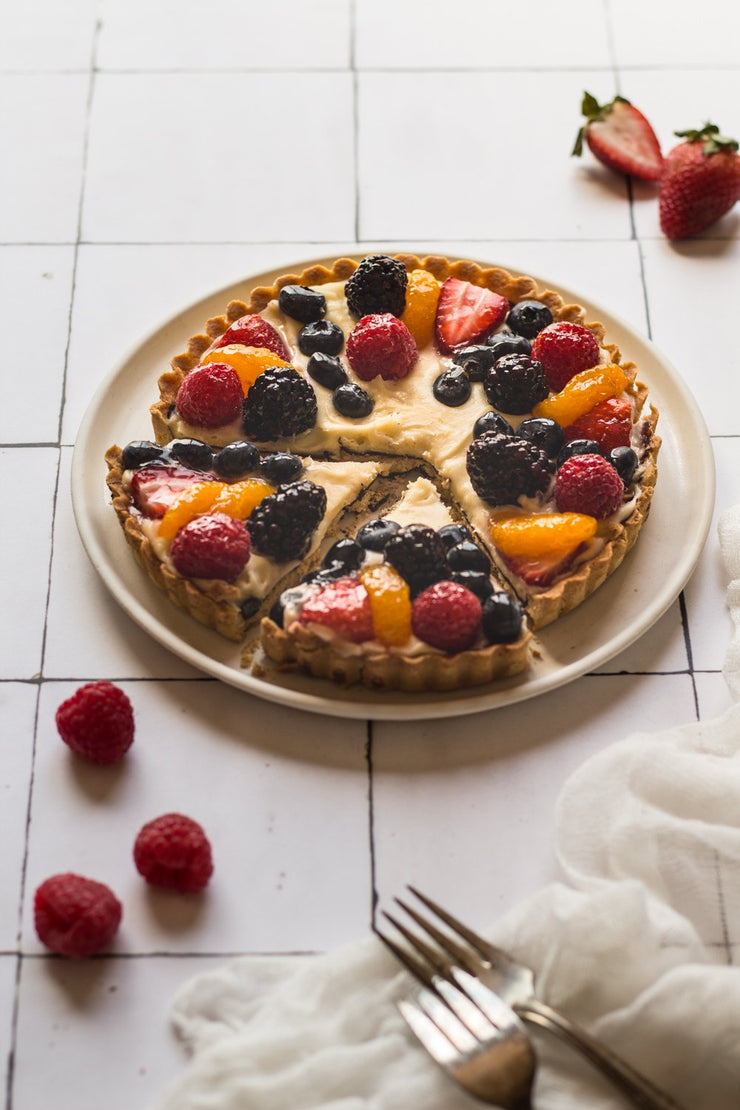 Mixed berry fruit tart on a plate with forks on a super-thin & pliable Moroccan Tile Replica Photography Backdrop