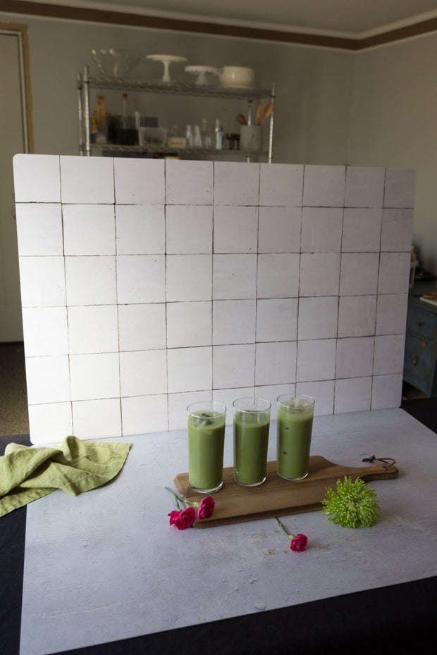 Green smoothies in glasses with a Moroccan Tile Replica Photography Backdrop