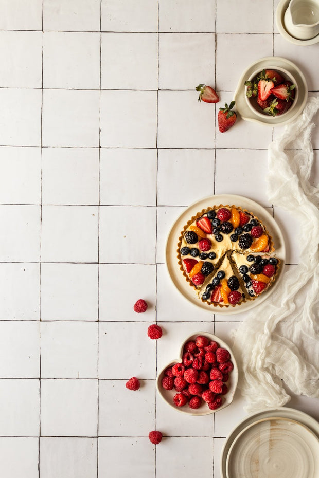 Fruit tart with raspberries and strawberries on a Moroccan Tile Replica Photography Backdrop
