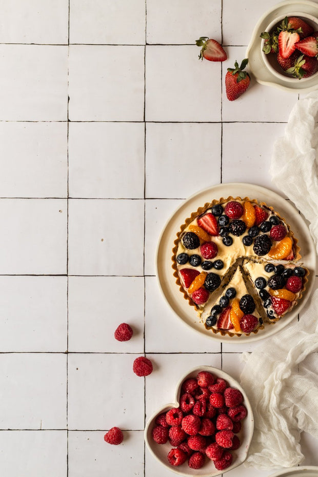 Berry Fruit tart with raspberries on a Moroccan Tile Replica Photography Backdrop