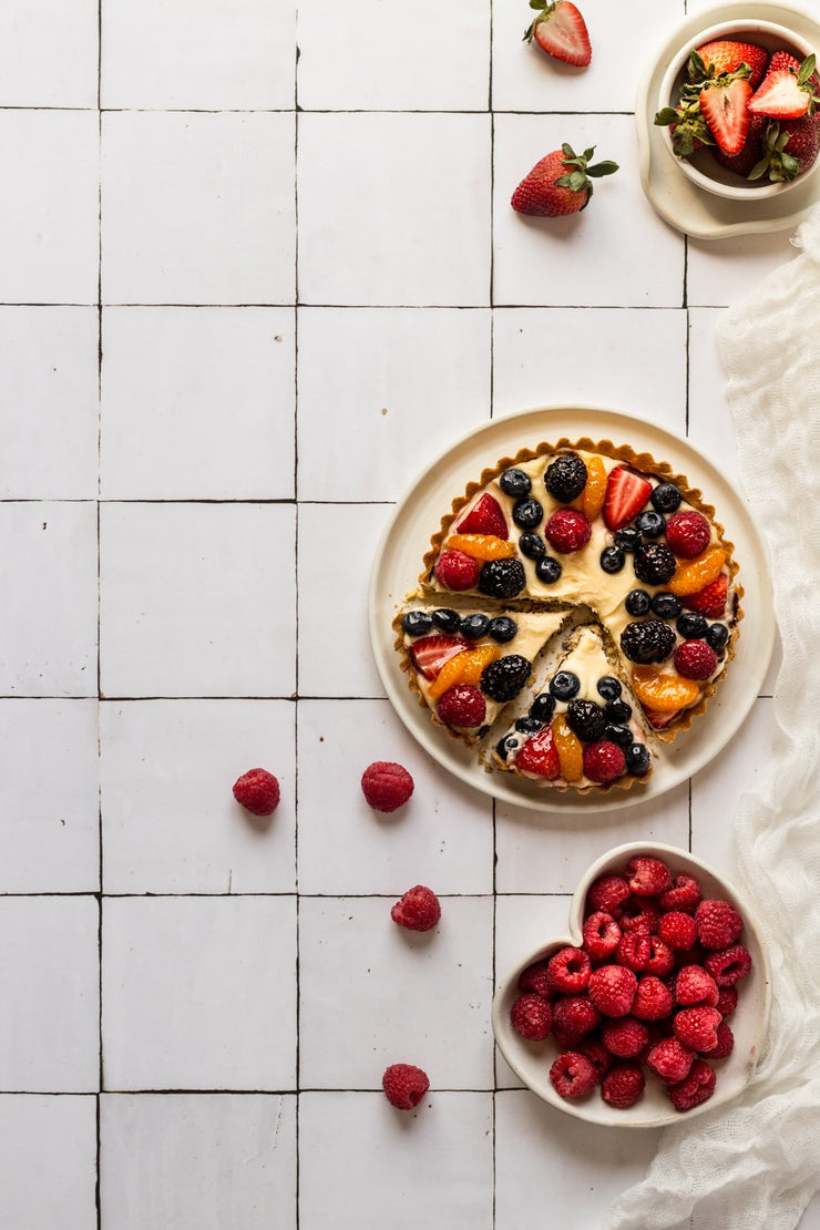 Sliced berry fruit tart on a plate on a Super-thin & pliable Moroccan Tile Replica Photography Backdrop
