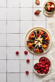 Sliced berry fruit tart on a plate on a Moroccan Tile Replica Photography Backdrop