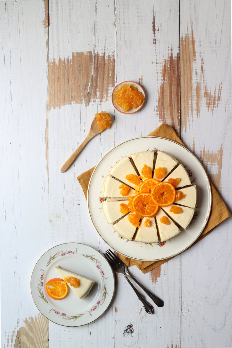 Super-Thin & Pliable Whitewashed Reclaimed Wood Replica Photography Backdrop 2 ft x 3 ft, Lightweight, Moisture & Stain-Resistant with cheesecake and oranges