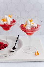 Glasses of Jelly with whipped cream, a spoon, and a Marble Hexagon Tile Replica Photography Backdrop
