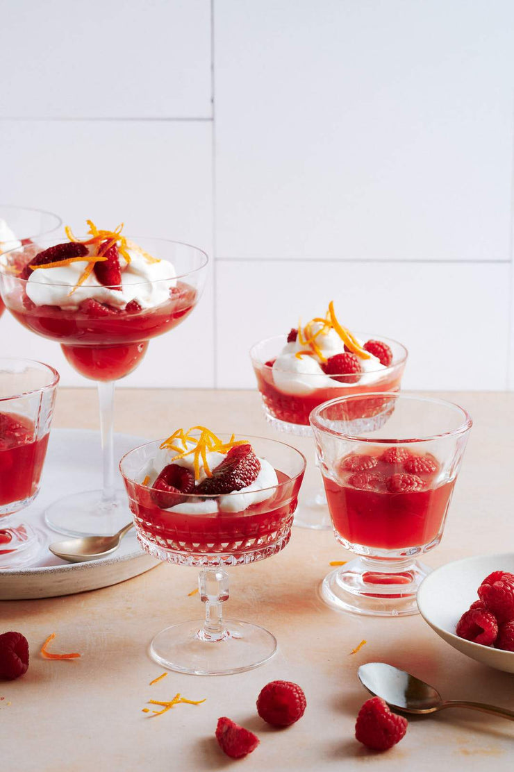 Glasses of red jelly with whipped cream and oranges with the Super-Thin & Pliable Creamy White Tile Replica Photography Backdrop