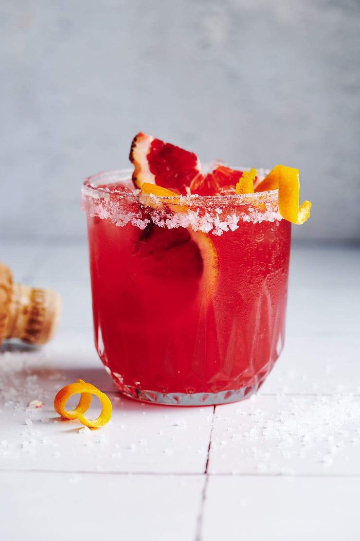 Red drink in a glass with blood oranges on a Super-Thin & Pliable Moroccan Tile Replica Photography Backdrop