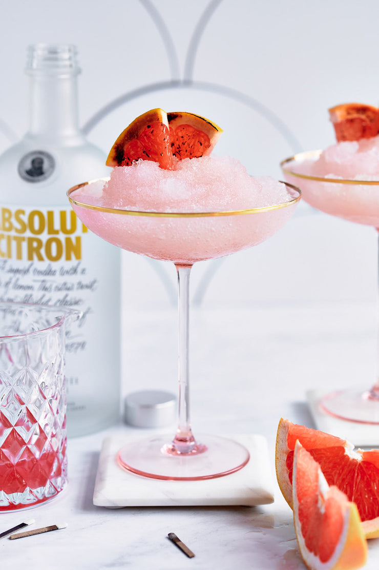 Pink Ice drink in glasses with oranges with a Super-Thin & Pliable Scalloped Tiles Replica Photography Backdrop