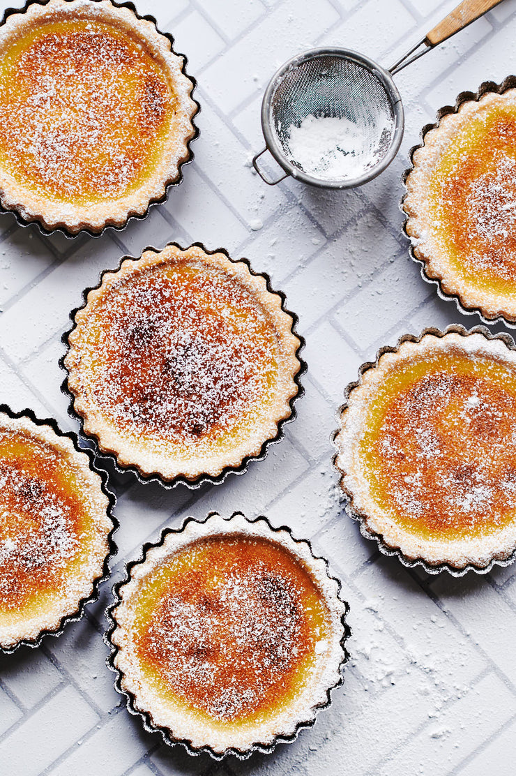 Chevron Tile Replica Photography Backdrop with bruleed tarts in tart pans