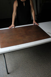 Rusty Metal Photography Backdrop 2 ft x 3ft board with a person holding it up