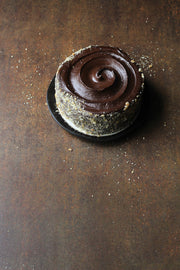 Rusty Metal Photography Backdrop 2 ft x 3ft board with a chocolate cake on a plate