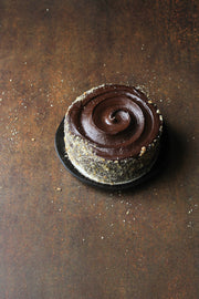 Rusty Metal Photography Backdrop 2 ft x 3ft board with a whole chocolate cake