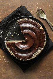 Rusty Metal Photography Backdrop 2 ft x 3ft board with a sliced chocolate cake