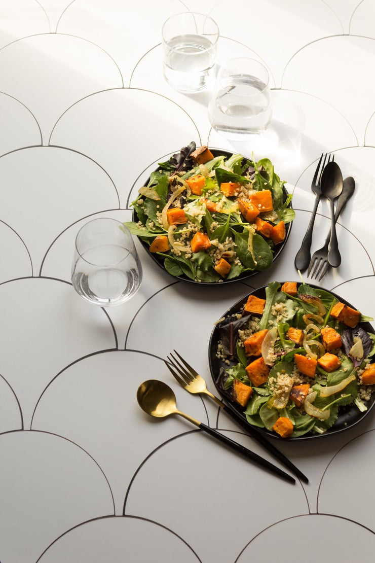 Two squash salads on plates on a Super-Thin & Pliable Scalloped Tiles Replica Photography Backdrop