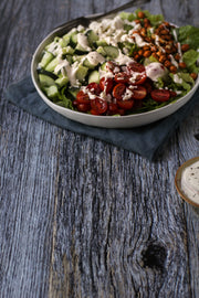 Silver Blue Reclaimed Wood Photography Backdrop 2 ft x 3 ft board | 3 mm thick with a salad on a plate up close