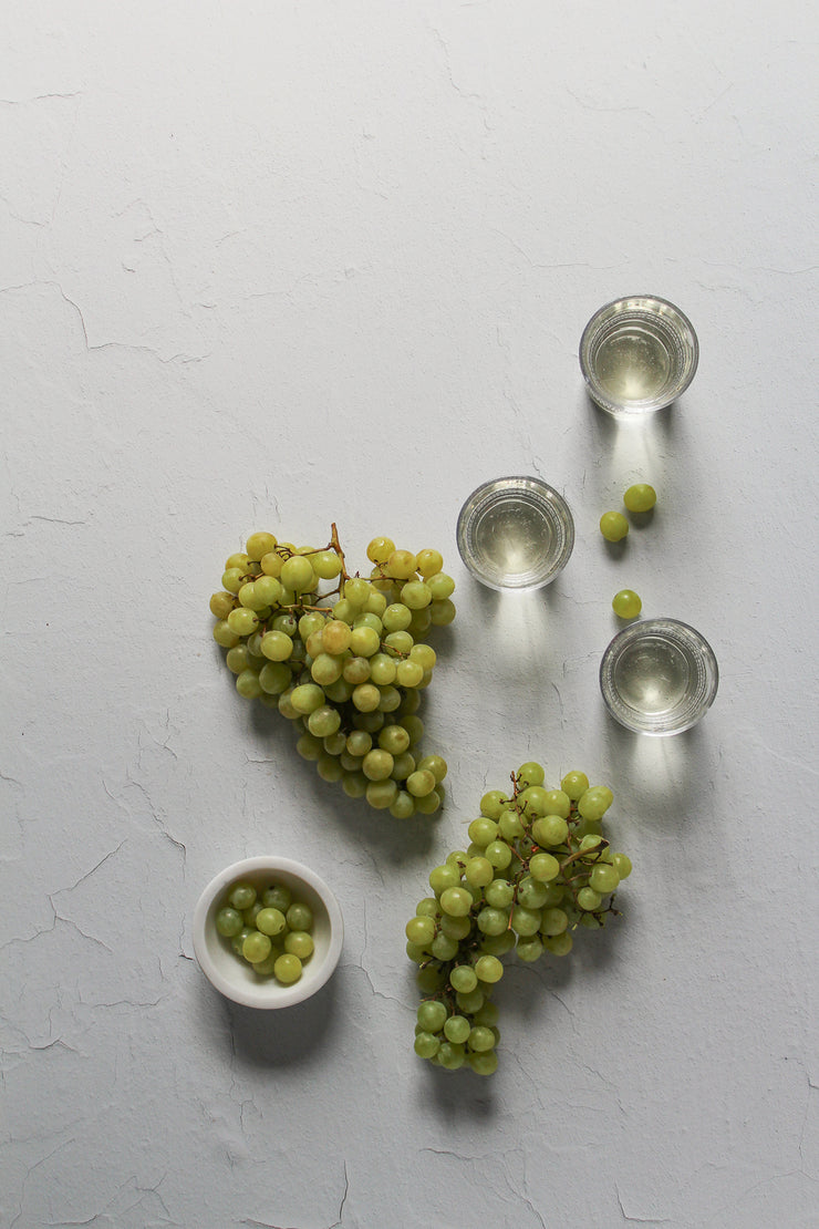 Super-Thin & Pliable Simple White Textured Photography Backdrop 2 ft x 3 ft, Lightweight, Moisture & Stain Resistant with green grapes and wine