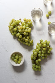 Super-Thin & Pliable Simple White Textured Photography Backdrop 2 ft x 3 ft, Lightweight, Moisture & Stain Resistant with wine and grapes