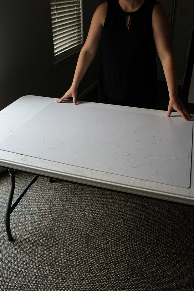 Simple White Textured Photography Backdrop 2 ft x 3 ft board with a person holding it