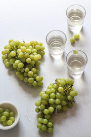 Simple White Textured Photography Backdrop 2 ft x 3 ft with grapes and glasses