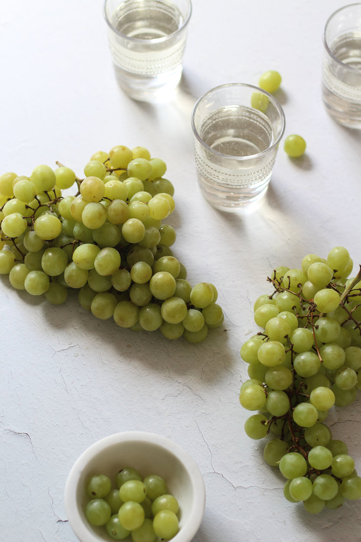 Super-Thin & Pliable Simple White Textured Photography Backdrop 2 ft x 3 ft, Lightweight, Moisture & Stain Resistant with green grapes