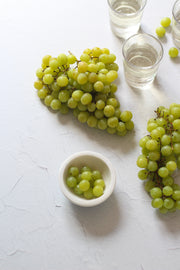 Simple White Textured Photography Backdrop 2 ft x 3 ft with grapes and glasses of wine