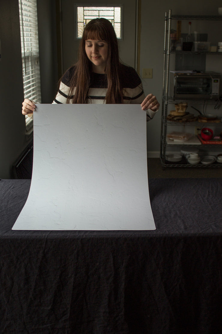 Super-Thin & Pliable Simple White Textured Photography Backdrop 2 ft x 3 ft, Lightweight, Moisture & Stain Resistant behind the scenes