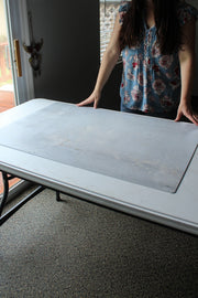 Soft Concrete Photography Backdrop Board 2 ft x 3 ft | 3 mm thick board with a person standing beside it
