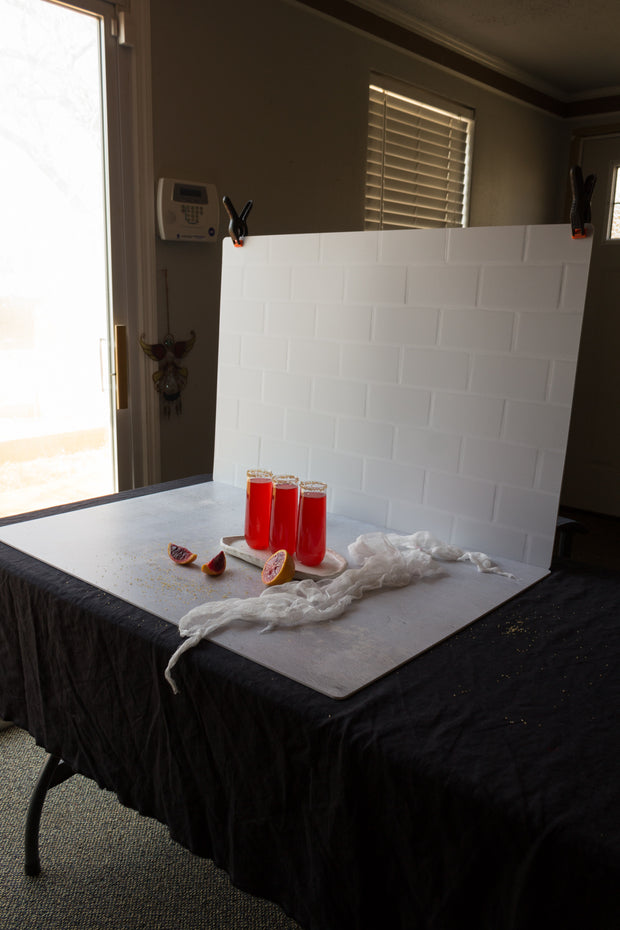 Subway Tile with White Grout Photography Backdrop behind the scenes with red drinks