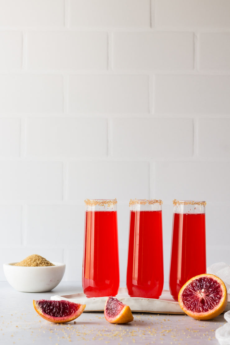 Super-Thin & Pliable Subway Tile with White Grout Photography Backdrop with glasses of sparkling red soda and blood oranges