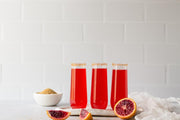 Super-Thin & Pliable Subway Tile with White Grout Photography Backdrop with three glasses of red soda with oranges