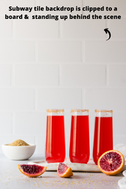 Super-Thin & Pliable Subway Tile with White Grout Photography Backdrop with glasses of red soda and oranges