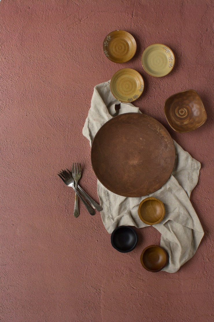 Terra Cotta Photography Backdrop 2 ft x 3ft board with brown plates and linen napkins
