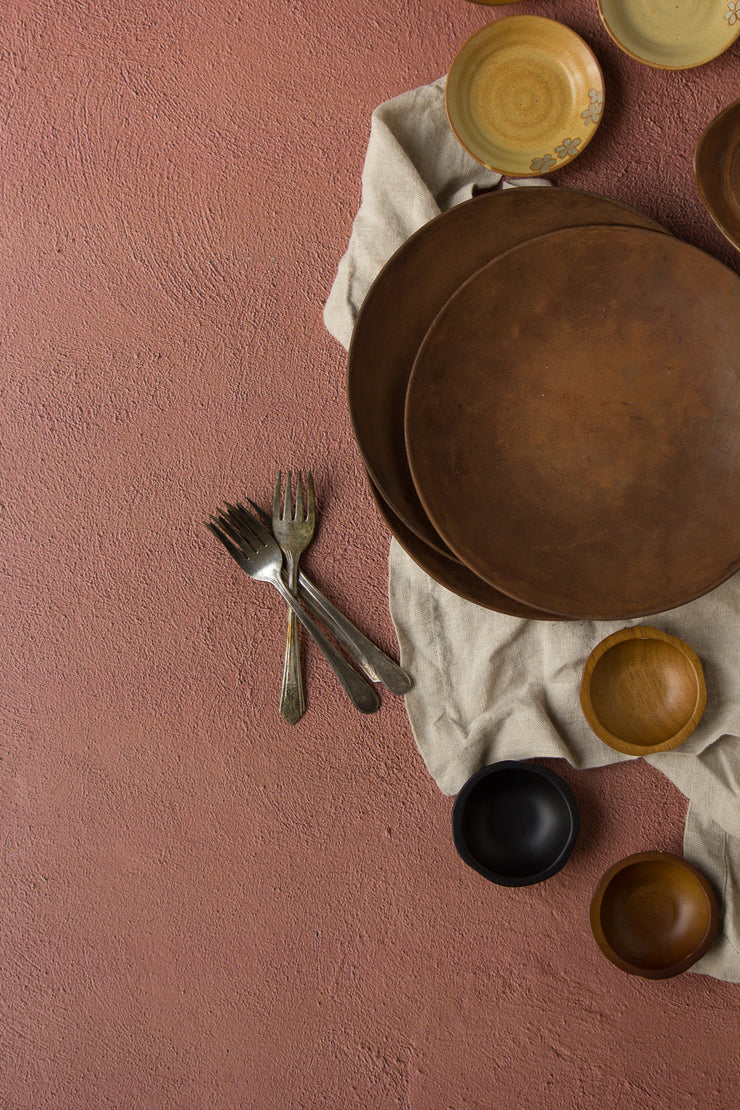 Terra Cotta Photography Backdrop 2 ft x 3ft board with brown plates and bowls up close